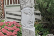 Stone Sculpture welcomes you in the front garden