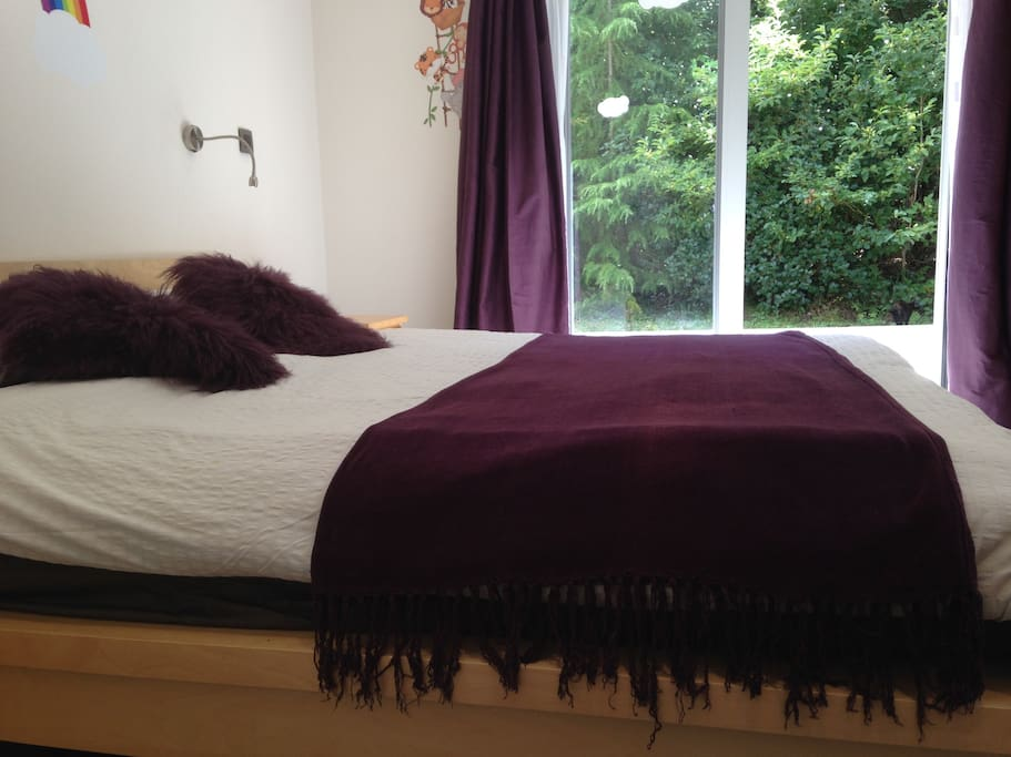 Super king sized bed with outlook onto woodland