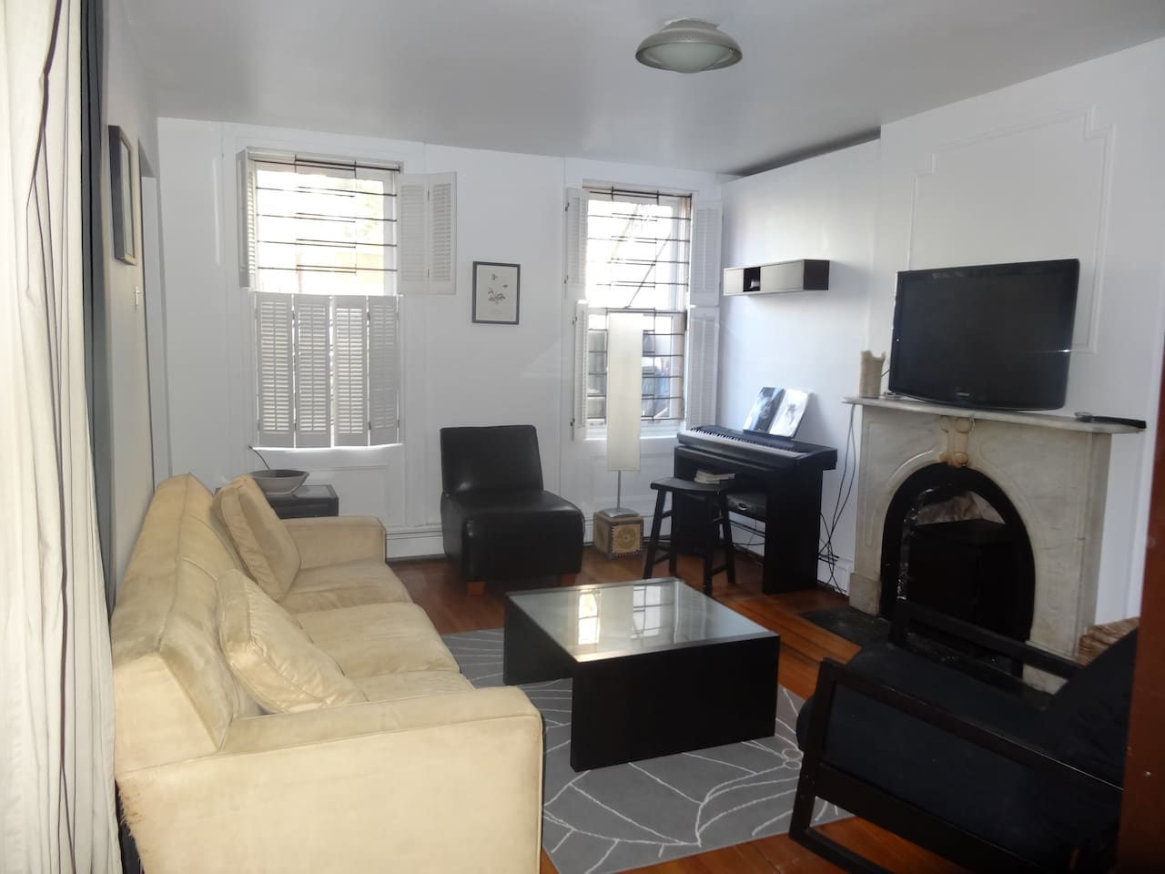 Living room with 40''flat screen HD TV with premium channels.