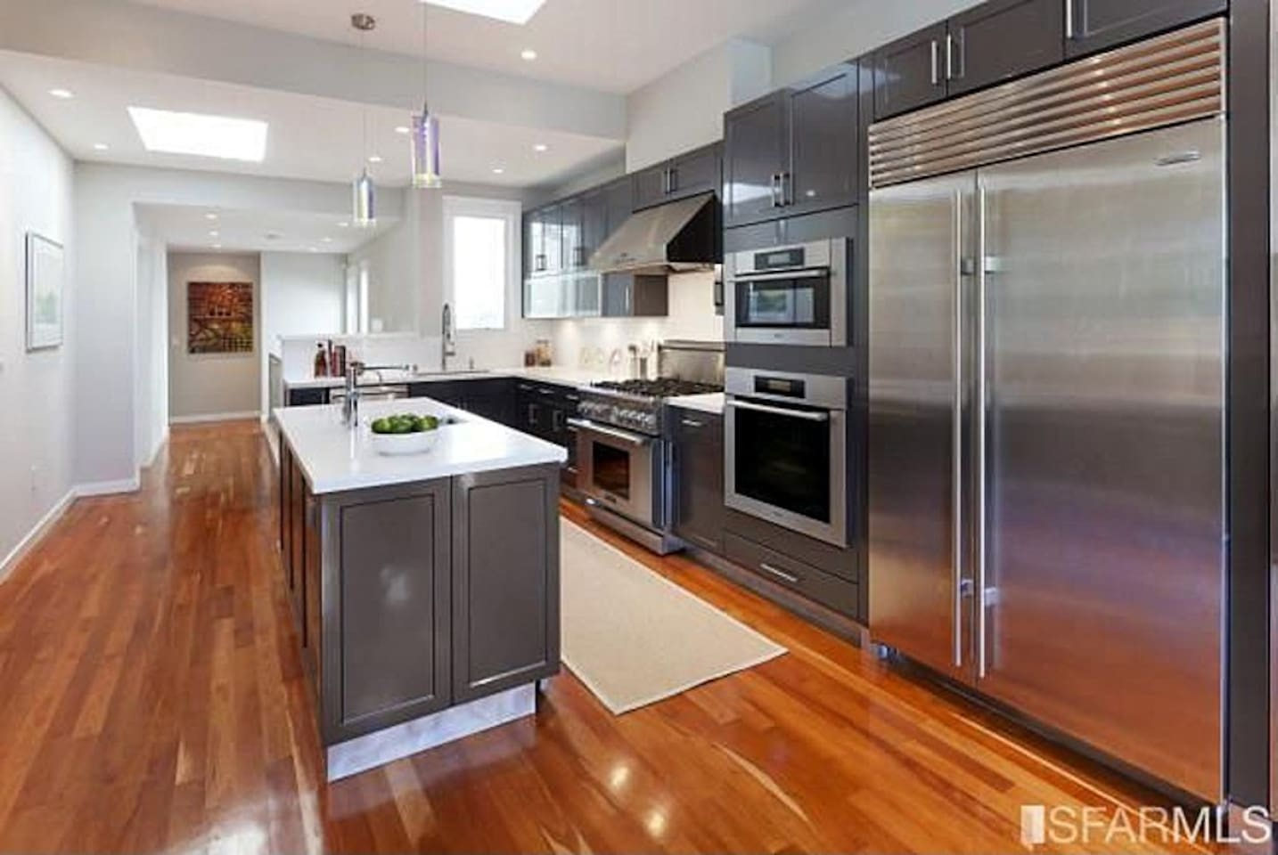 Gourmet chef's kitchen with top of the line appliances, six-burner stove, wine and beverage refrigerators, and all kinds of cooking gadgets (slow cooker, KitchenAid stand mixer, juicer, Vitamix blender, sous vide, rice cooker, etc.)