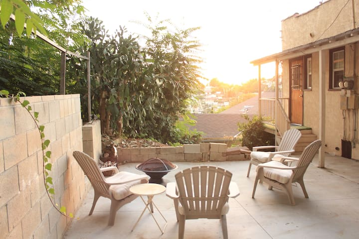 The shared back yard with a fire pit, gas grill and beautiful sunsets!
