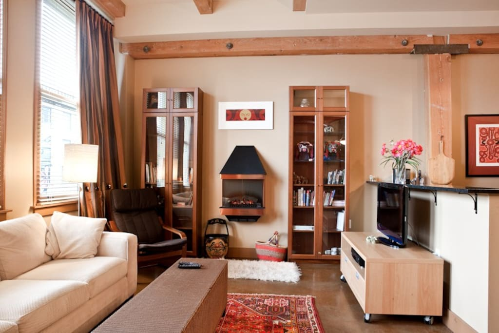 A warm fireplace with exposed beams saved from the original Victoria Hotel
