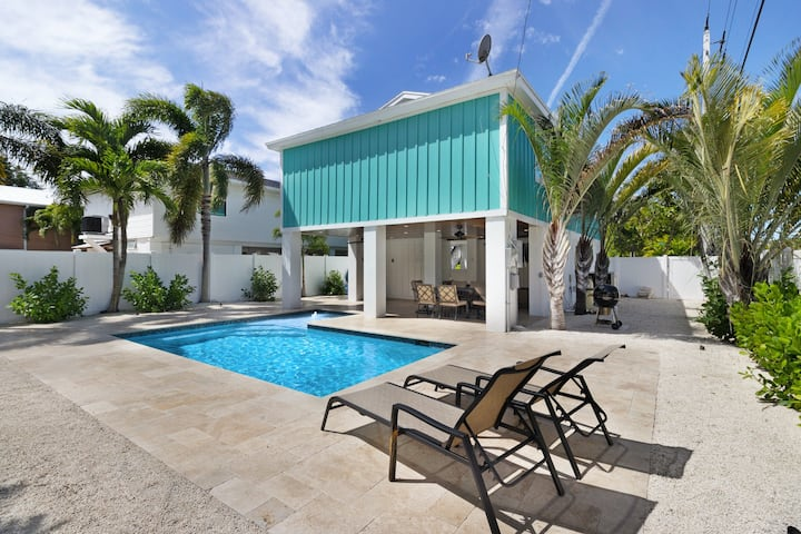 New listing! Pet-friendly home with heated private pool, short walk to the beach