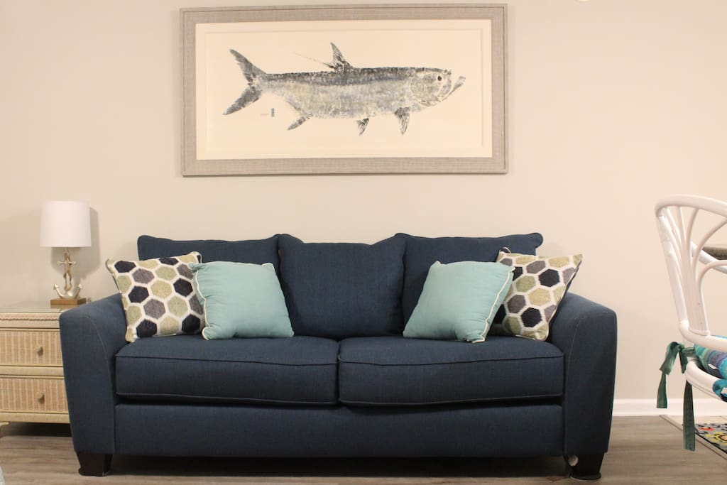 Our coastal decor complements this queen size sofa sleeper. The comfy feel of this space will make our guests feel right at home in this condo.