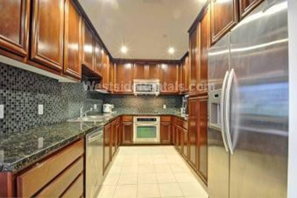 stainless steel appliances, silverware, microwave,refridgerator, super clean