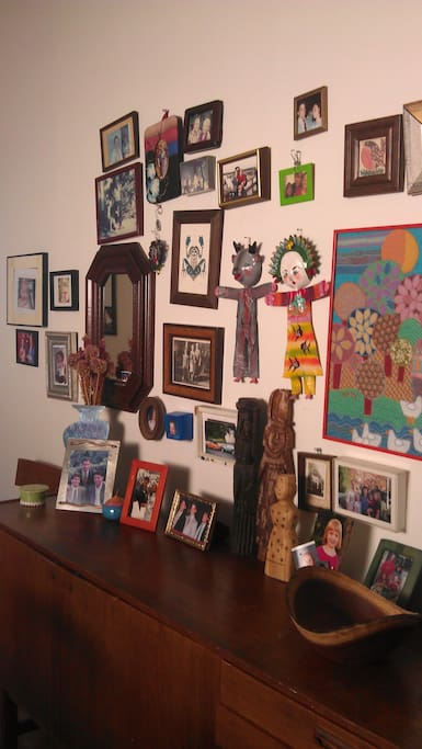 Art and photos on dining room wall.