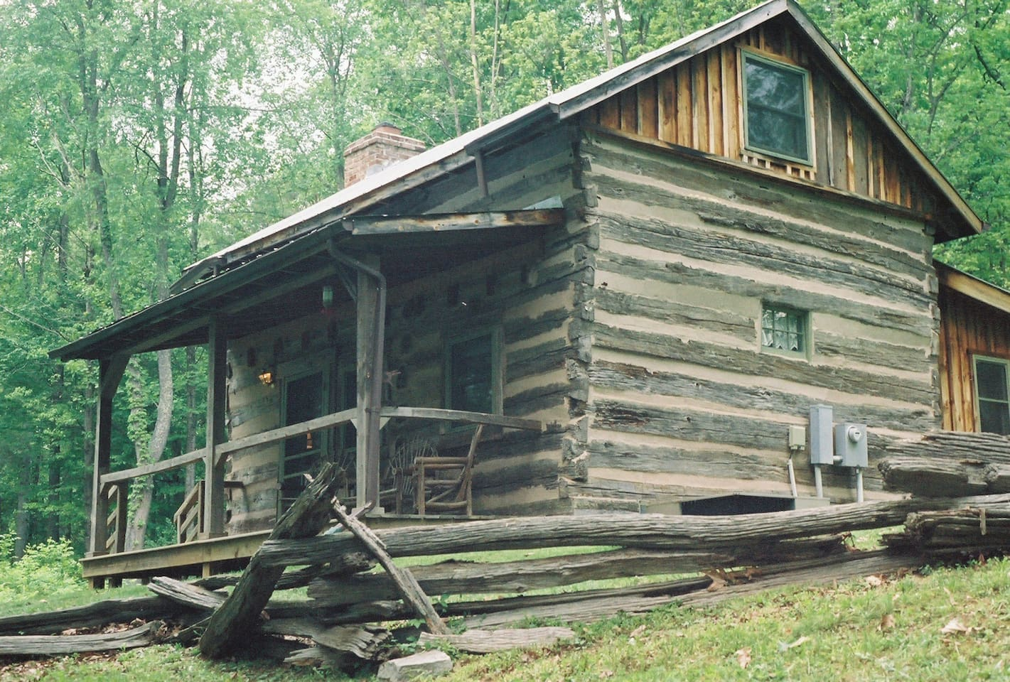 Log Cabin on knoll in meadow with private road access. This cabin c 1775 was moved from West Virginia & reconstructed adding a 2nd floor bedroom, a screened-in sitting porch, a kitchenette & a large bathroom.