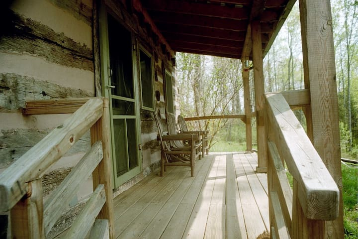 Sitting porch with authentic bent twig furniture.