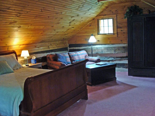 Loft bedroom is spacious. A very comfortable bed with quality bedding & a hypoallergenic goose down filled love seat.