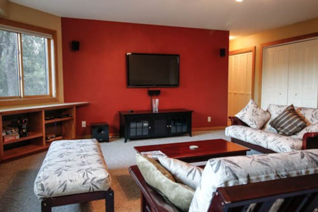 """52"""" TV with surround sound, dish TV and music system."""