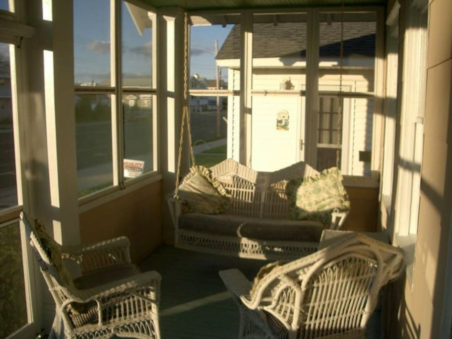 Screened porch, wicker swing--best room in the house.