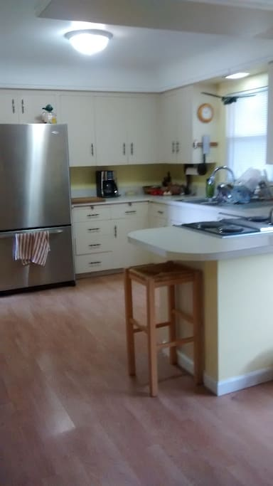 Open kitchen with all appliances.