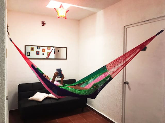 Common area with sofa bed and hammock