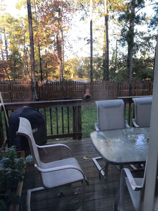 Back yard is fenced in for your dog.  Relax on the back deck and watch the sunset.