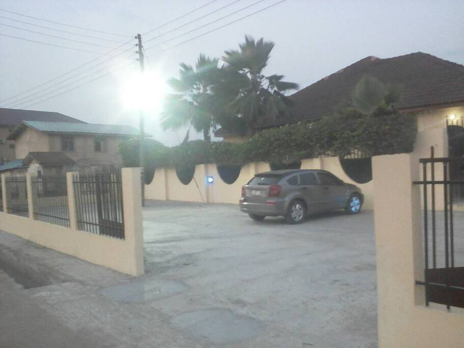 Front entrance at night with ample parking space