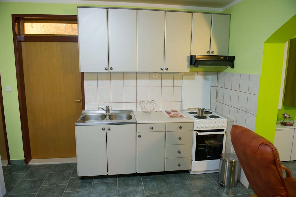 The kitchen with stove, oven, refrigerator + deep freeze, everything needed for cooking...
