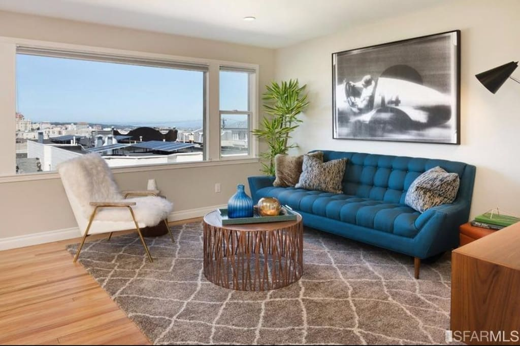 Open floor plan with view of golden gate from living room. Some furniture has been replaced.