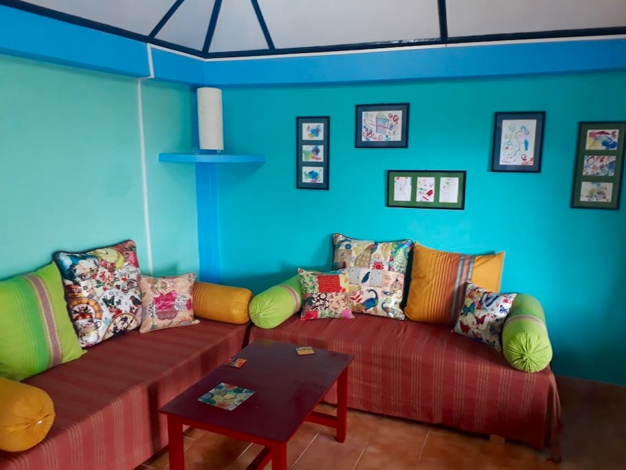 Comfortable and colourful, relax in our sitting area!