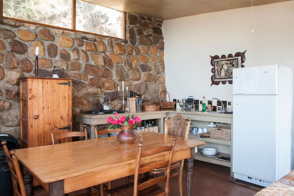 Self-catering kitchen includes a refrigerator, Weber Braai, and basic refreshments such as biscuits and tea