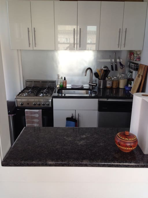 Fully equipped kitchen with gas stove top, oven and dishwasher.