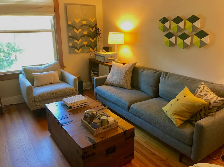 Living room with plenty of cozy places to sit and talk or watch a movie.