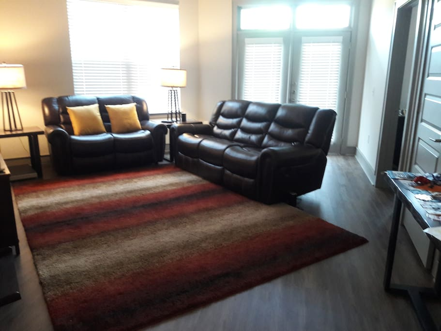 Living room with electric, reclining couch and love seat