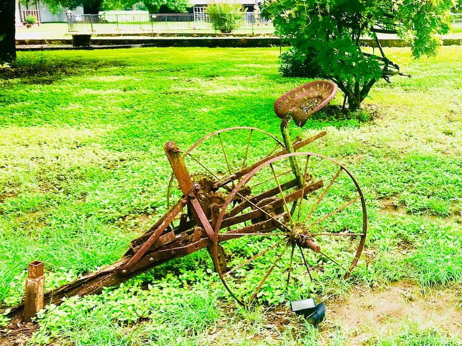 Antique farm equipment surround this ranch, bringing you back around for more of this rich land-cultivated property.