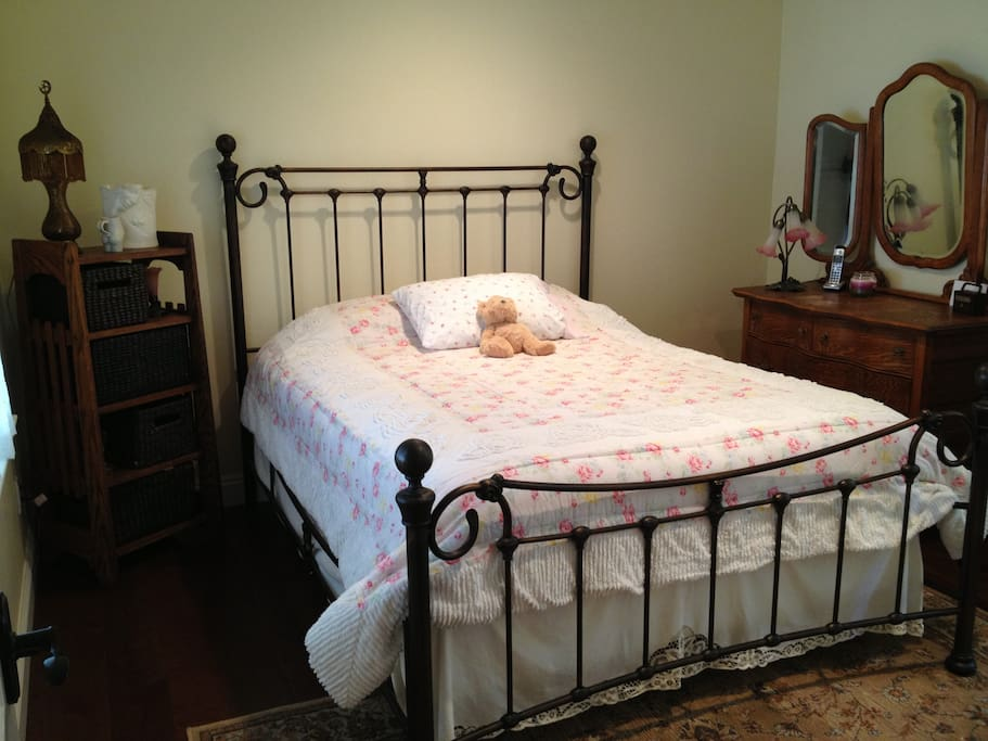 Queen size bed w/ shared bathroom.
