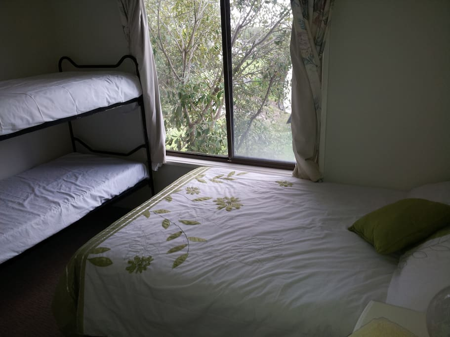 Bedroom 2 has one double bed and two single bunk beds