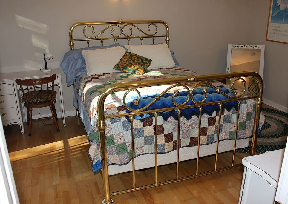 We replaced the old trundle bed with a big brass bed and brand new queen mattress