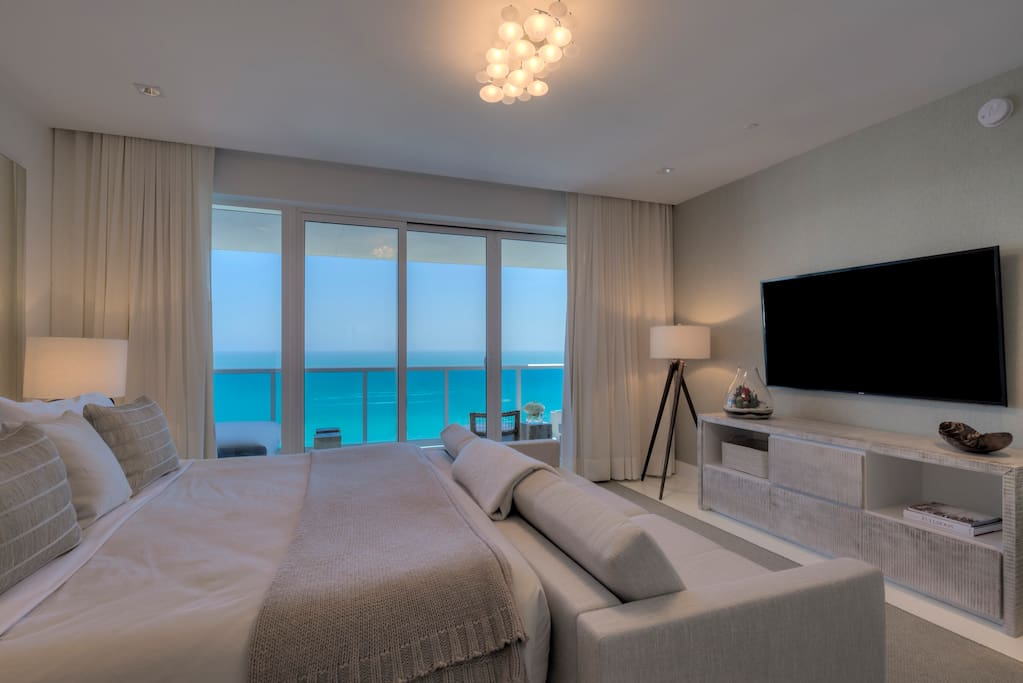 Master bedroom with private balcony, king bed