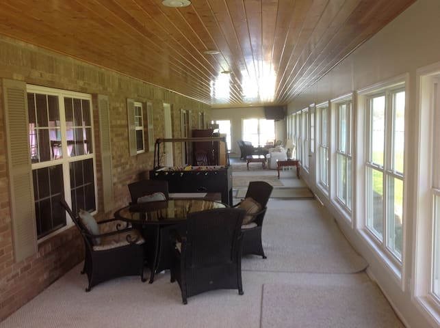 Lanai wraps around house and can be used as additional space for more guests.