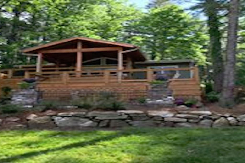 Three tiers of decking and a stone patio provide lots of space for outdoor entertaining.