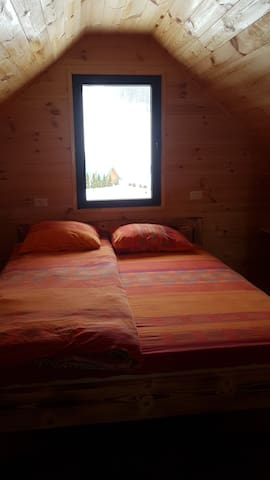 Room with double bed and view on city ski resort Javorovaca