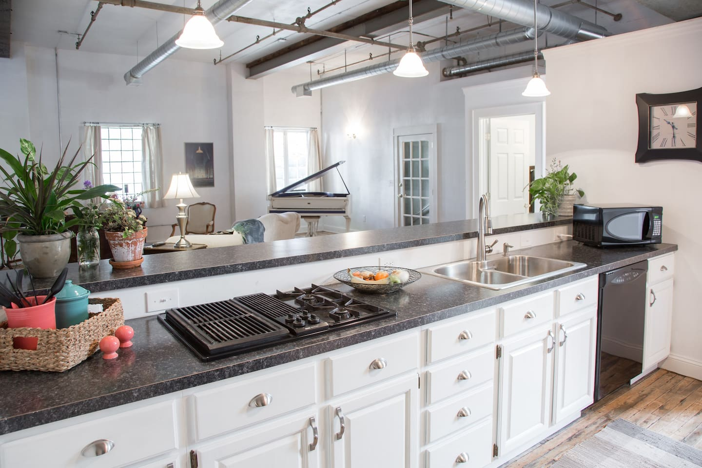 The spacious galley-style kitchen is open to the living space and if you decide not to eat out, it has all of the necessities you need for cooking at home.