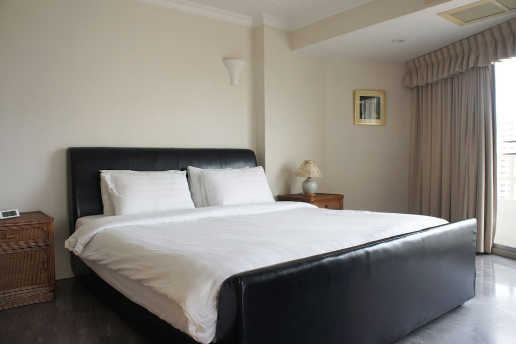 Large, modern, chic, bedroom, with a King-Size bed. Fully air-conditioned for you comfort.