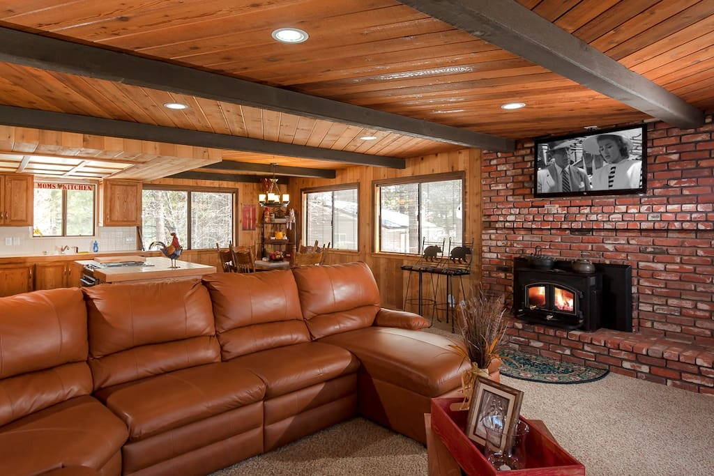 Open Floor plan living area with wood burning fireplace with  Huge LCD TV