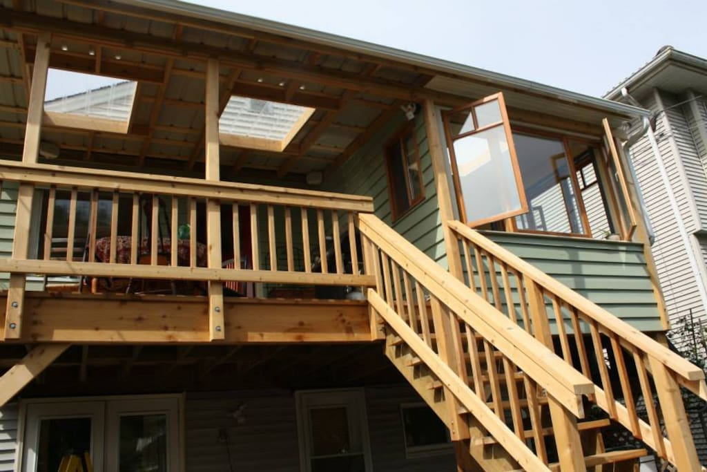 Newly built back deck with table and sunroom