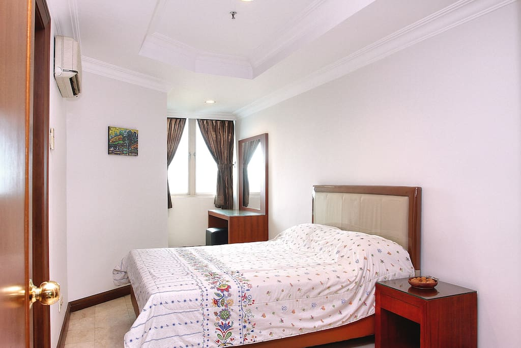 Spacious bedroom with all new mattress, bedside table and vanity/work desk