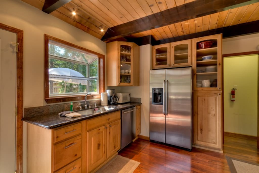 Stainless steel appliances, exposed beams and maple cabinetry in the kitchen