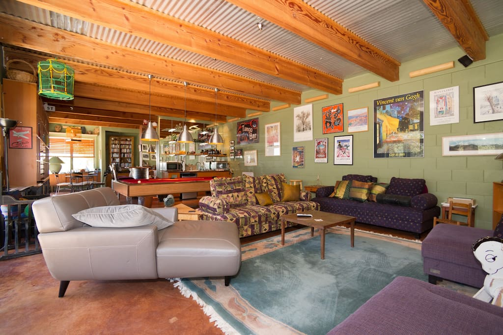 Entertainment room with pool table, wet bar and audio/visual center.