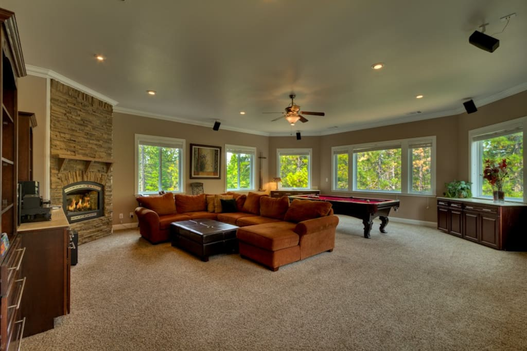 Spacious den complete with pool table, big screen HDTV, and fireplace