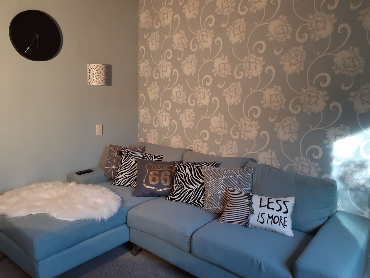 Separate lounge room with a comfy suite