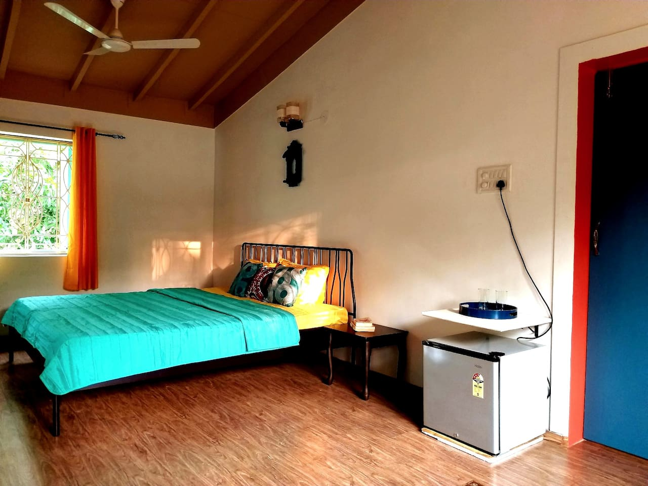 Tastefully done room with wood flooring, living room, day bed, balcony, wi-fi, AC, TV, mini fridge, electric kettle, tea/coffeemaker, bath essentials, water heater
