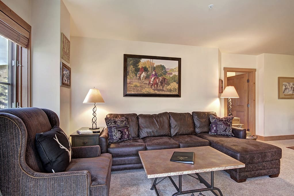 Modern Furnishings - There is a sectional sofa and modern arm chair.
