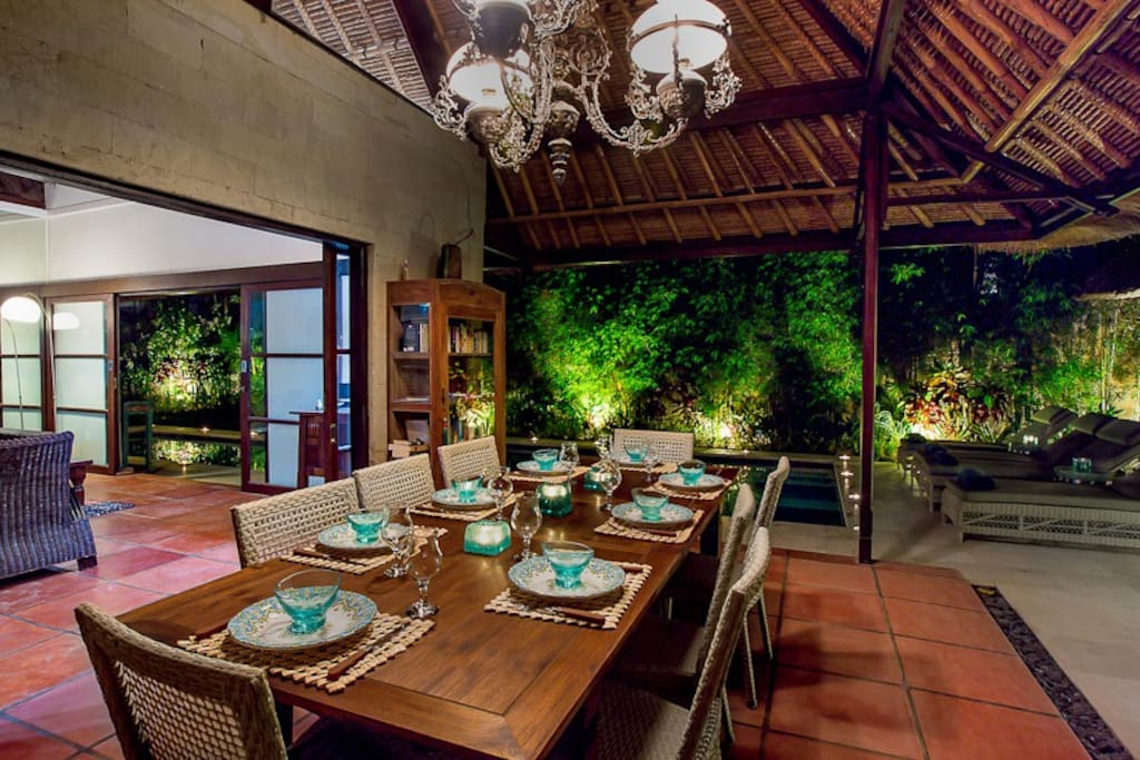 Dine under soaring bamboo roof with hanging chandelier