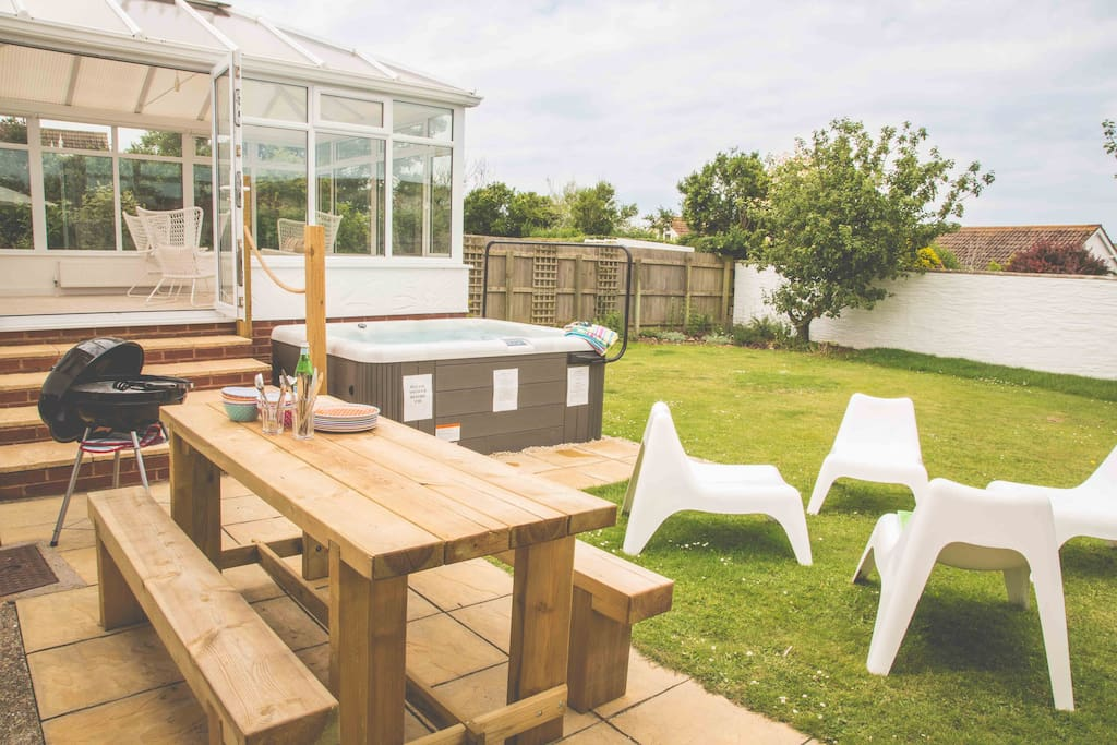 Garden with hot tub, BBQ & relaxed dining