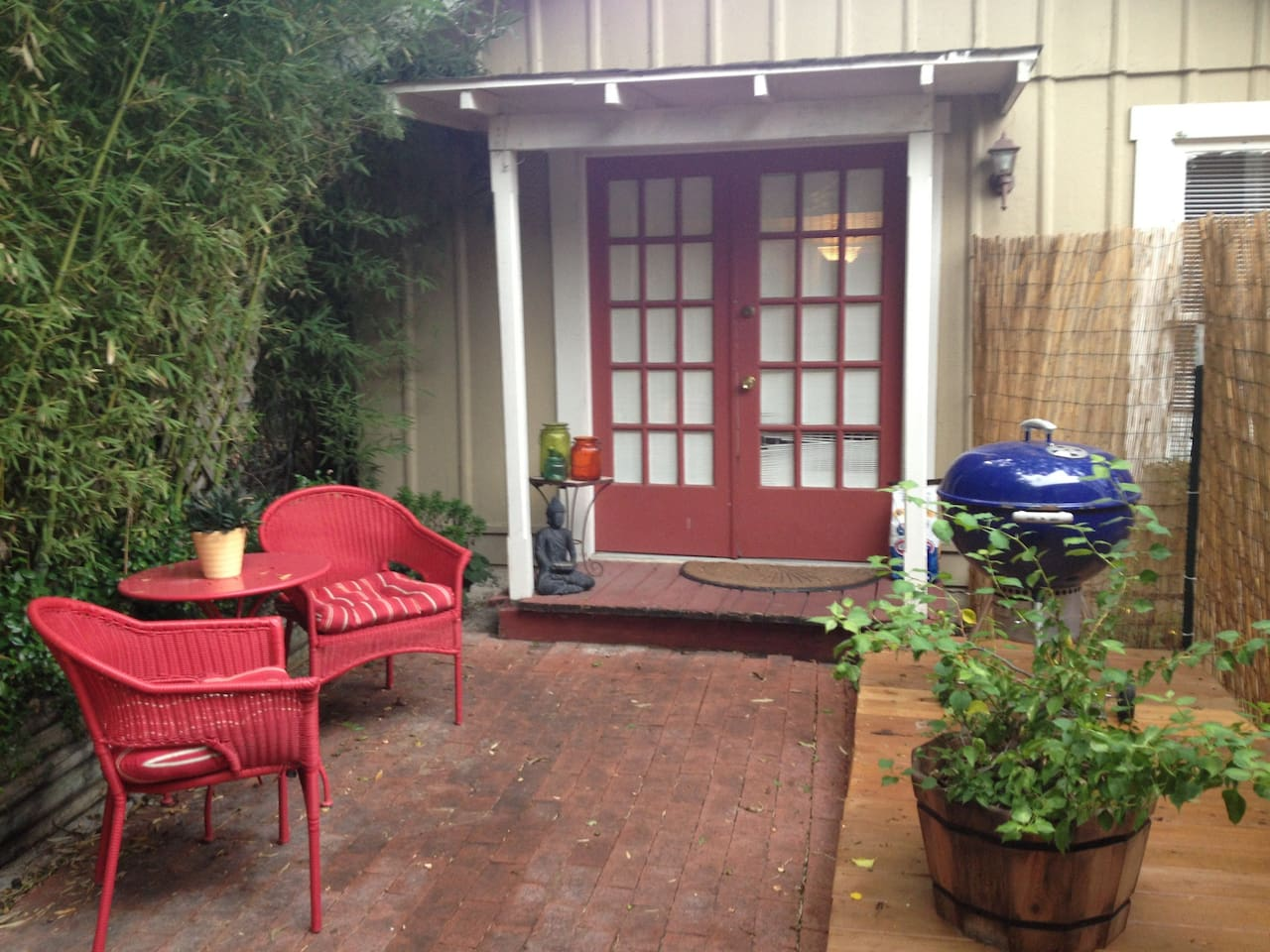 Charming private entrance with private fence and deck with grill