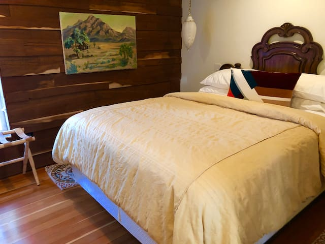 """The bedroom has a comfy queen size bed and 43"""" flat screen television."""