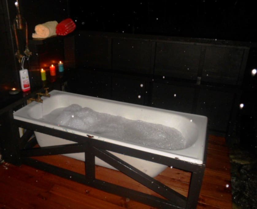 Relax with a vino in the outside bath, next to the brazier, room for two or go solo!